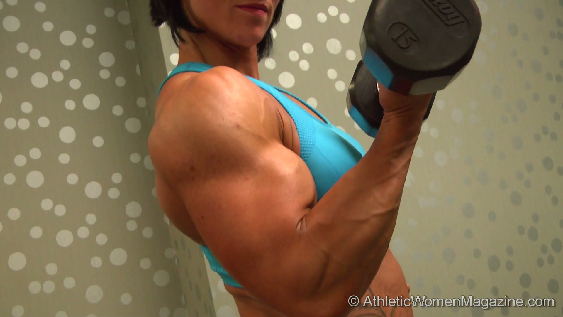 FBB Big Biceps http://www.athleticwomenmagazine.com/free/picthumb/092/index00.htm